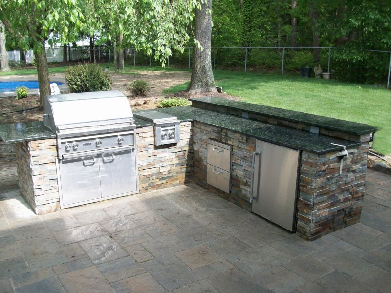 Outdoor kitchen and bar with granite top