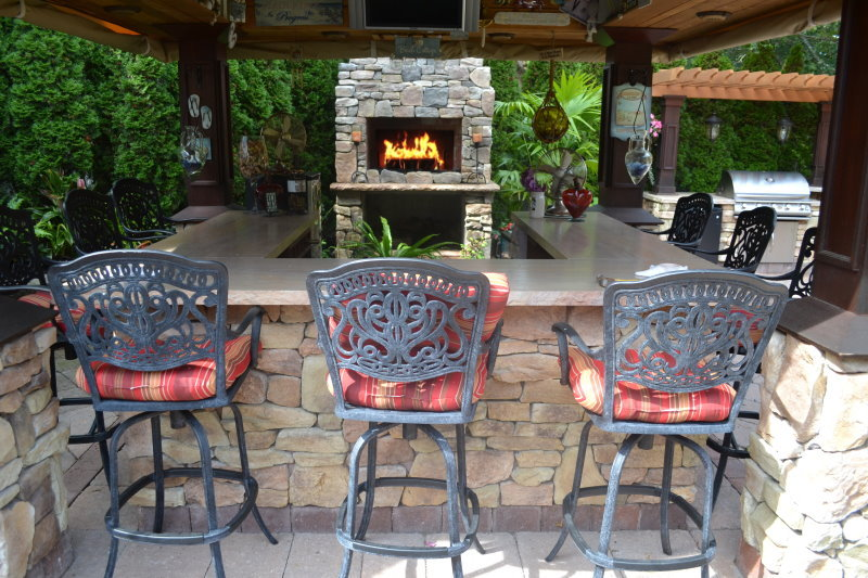 outdoor bar island with fireplace