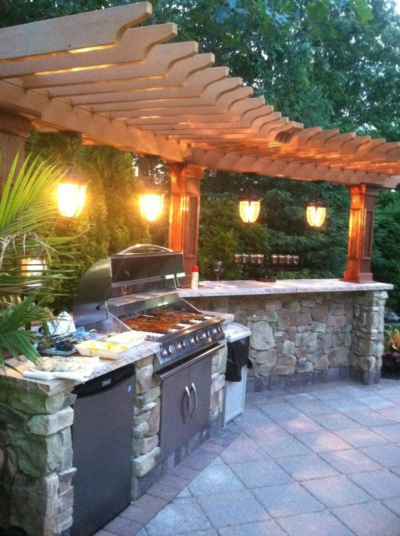 outdoor kitchen island with overhead lights