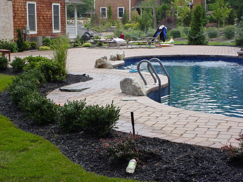 pool patio with plantings