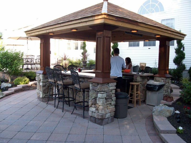 patio with outdoor bar island and pavilion