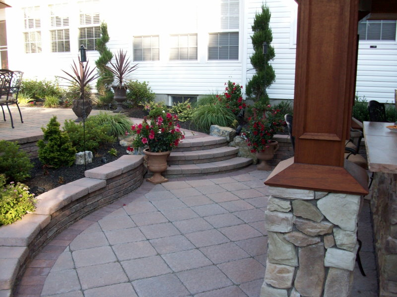 multi-level techo-bloc patio with steps