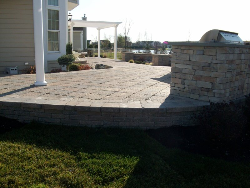 raised patio with outdoor kitchen island