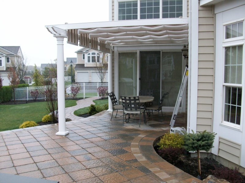 pergola with slide shade attached to house