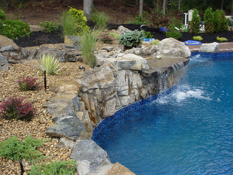 moss rock waterfall into pool