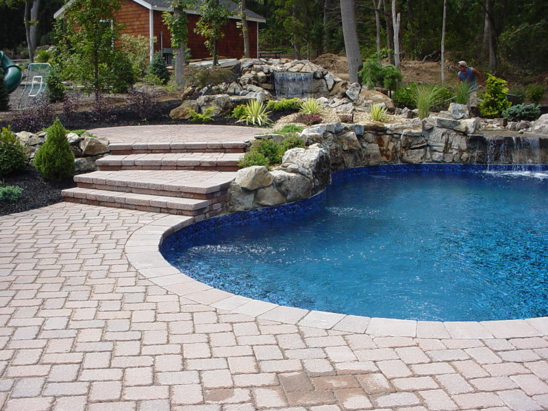 Raised pool patio with waterfall