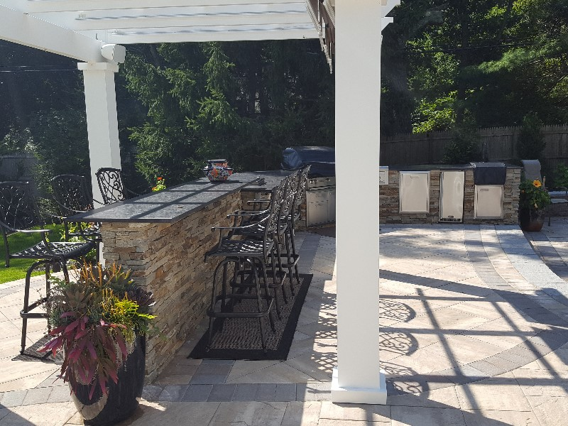 Outdoor kitchen with double faced bar