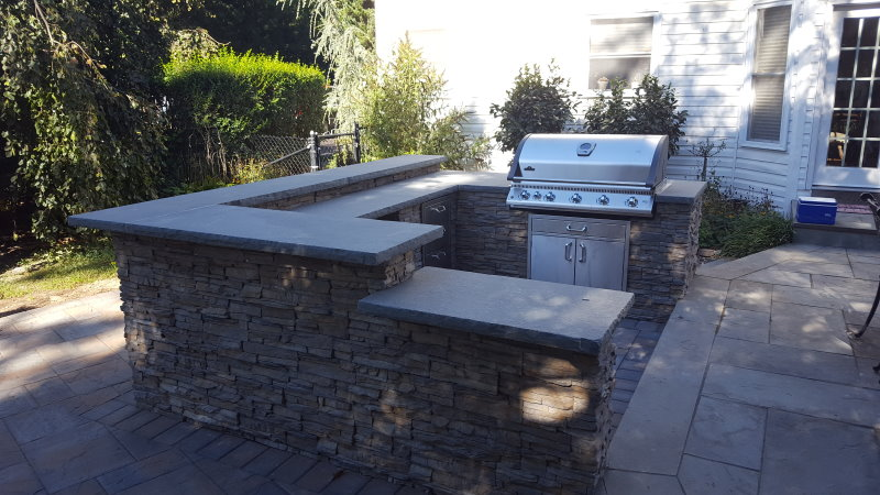 Outdoor kitchen with bar area